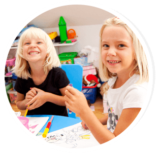 two preschool girls in their classroom